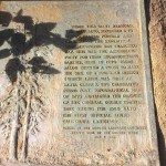 This plaque placed in 1926 is cemented to a rock in front of the historic redwood tree.
