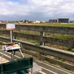 My easel set up on the pedestrian bridge over Stevens Creek