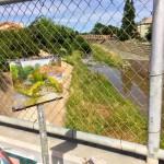 Painting behind the fence on the San Antonio Street Bridge