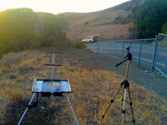 Packing up, a view of my easel and SUV along Metcalf Rd.